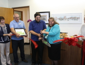 The ribbon cutting. Ossian Law open house celebration, 6/11/13
