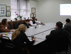 "Photo from May 15th presentation on ""Twibel and Other Online Defamation"" -- attendees sitting around table at presentation."